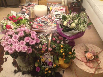 Yane Rudkovskaya sent several lush bouquets of flowers to March 8
