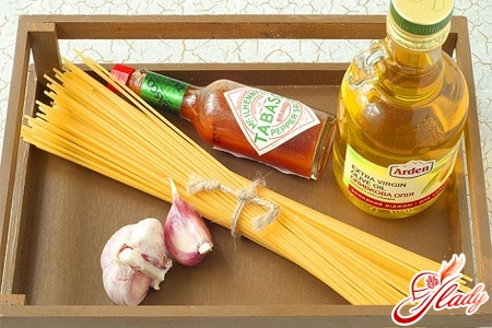 ingredients for cooking spaghetti with sauce