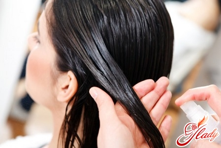 oil spraying on hair