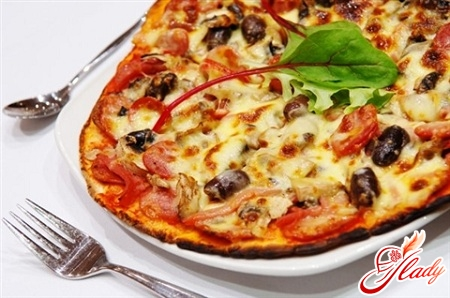 delicious pizza with mushrooms and sausage